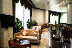 Cafe. Interior of luxurious cafe with leather sofas and chairs Royalty Free Stock Photos
