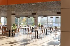 Free Cafe Interior. Modern Cafe Interior With Bright Room With Tables And Chairs Nobody, Large Windows, Modern Style Royalty Free Stock Photo - 148880255