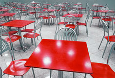 Cafe interior with red tables and chairs Royalty Free Stock Photography