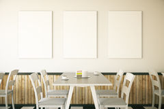Cafe interior with three posters Stock Photos