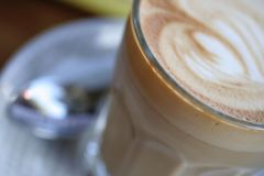 Cafe Latte. Close up view of cafe latte in a glass at a coffee shop Royalty Free Stock Photography
