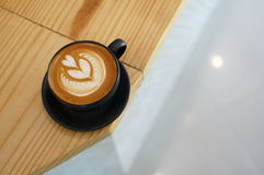 Cafe latte. Beautyful latteart cup royalty free stock image