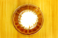 Cafe latte on brown plate Stock Images
