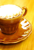 Cafe Latte with brown plate Royalty Free Stock Images