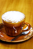 Cafe Latte with brown plate Royalty Free Stock Photos