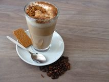 Cafe latte with cinnamon and biscuit Stock Photos