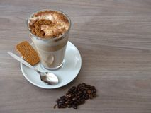 Cafe latte with cinnamon and biscuit Royalty Free Stock Photo
