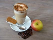 Cafe latte with cinnamon biscuit and apple Stock Image