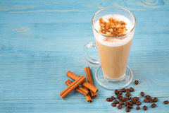 Cafe latte and coffee beans and cinnamon Stock Photos