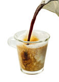 Cafe Latte. Espresso pouring into steamed milk for a cafe latte on a white background Royalty Free Stock Photo