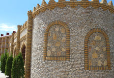Cafe like a tower or castle near the motel. Ancient stone wall yellow, brown, close-up, background. cafe like a tower or castle near the motel royalty free stock photography