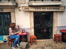 Cafe in Lisbon. Cafe Do Electrico bar ona Rua do Salvador street in Alfama district of Lisbon, Portugal royalty free stock images