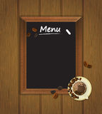 Cafe menu board with cup of coffee and coffee beans Stock Image