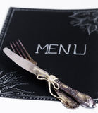 Cafe menu restaurant on the black sheet with a white background Royalty Free Stock Photos