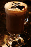 Cafe mocha. Drink topped with chocolate syrup royalty free stock photos