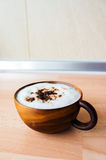 Cafe Mocha in wooden cup. On table royalty free stock images