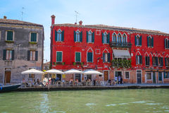 Cafe near a channel in Venice Royalty Free Stock Images