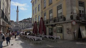 Cafe near Rossio Square. Typical scene for visitors to Lisbon Portugal stock video footage