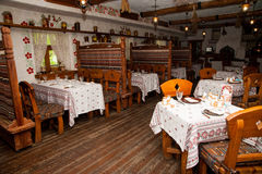 Cafe, old Russian style. Cafe interior, old Russian style, wooden furniture Royalty Free Stock Image