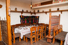 Cafe, old Russian style. Cafe interior, old Russian style, wooden furniture Stock Photography