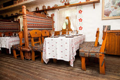 Cafe, old Russian style. Cafe interior, old Russian style, wooden furniture Royalty Free Stock Photos