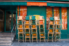 Cafe before opening. Chairs at cafe are put waiting for opening Royalty Free Stock Image