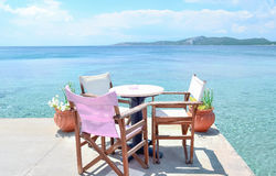 Comfortable cafe. Cafe overlooking the azure sea Royalty Free Stock Images