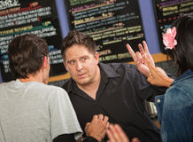 Cafe Owner with Rude Customer Royalty Free Stock Photography