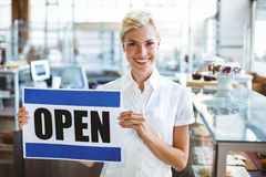 Cafe owner smiling at the camera Royalty Free Stock Photo