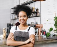 Cafe owner standing with arms crossed Stock Image