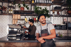 Cafe owner standing at the counter Royalty Free Stock Photography