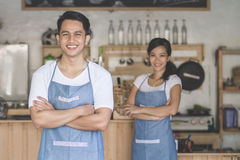 Cafe owner standing with crossed arms Stock Images