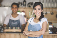 Cafe owner standing with crossed arms Stock Image
