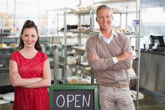 Cafe owners smiling at the camera Royalty Free Stock Photos