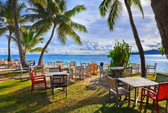 Cafe and palms on a tropical beach royalty free stock images