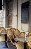 A cafe in Paris. A small terrace in Paris were you can enjoy a drink, a coffee or a full menu Royalty Free Stock Photo