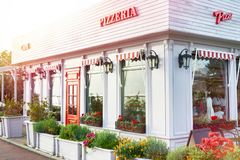 Cafe pizzeria. And flowers bed royalty free stock photo