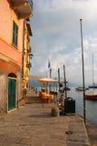 Cafe on the Portofino quay. Diferent boats near the Portofino quay Stock Images