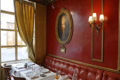 The Cafe Procope interior in Paris with portraits of famous writers and revolutionnary politicians Benjamin Franklin, Jean Jacques Stock Image
