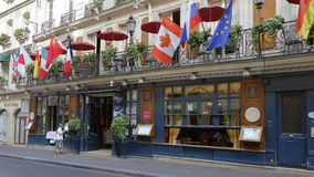 The Cafe Procope in Paris with portraits of famous writers and revolutionnary politicians Benjamin Franklin, Jean Jacques Rousseau Stock Photography