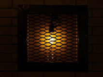 Cafe, pub or bar decorations. Old, vintage lamp behind bars on a Stock Photos