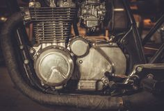 Cafe-racer motorcycle engine. Close-up of a cafe-racer motorcycle engine royalty free stock photo
