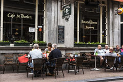 Cafe restaurant in Amsterdam. AMSTERDAM, NETHERLANDS, JULLY 9  2016.cafe de doelen in typical district of Amesterdam with people sitting on a terrace Royalty Free Stock Photos