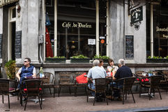Cafe restaurant in Amsterdam. AMSTERDAM, NETHERLANDS, JULLY 9  2016.cafe de doelen in typical district of Amesterdam with people sitting on a terrace Stock Images