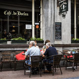 Cafe restaurant in Amsterdam. AMSTERDAM, NETHERLANDS, JULLY 9  2016.cafe de doelen in typical district of Amesterdam with people sitting on a terrace Stock Image