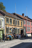 Cafe restaurant Bakklandet Trondheim. Cafe and restaurant with tables on the sidewalk in old wooden residential street house at Bakklandet in Trondheim, Norway Royalty Free Stock Photography