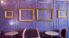 Cafe or Restaurant decorate with wooden wall and gold picture fr Stock Image