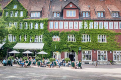 Cafe restaurant on a summer day. With green plant background Royalty Free Stock Photo