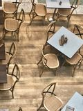 Cafe restaurant tables. Interior tables and chairs on the wooden floor view from above Stock Photos