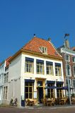 Cafe restaurant with terrace. Old rural holland, cafe restaurant with outside terrace and umbrellas.  Clear summer day. Vacation concept Royalty Free Stock Image
